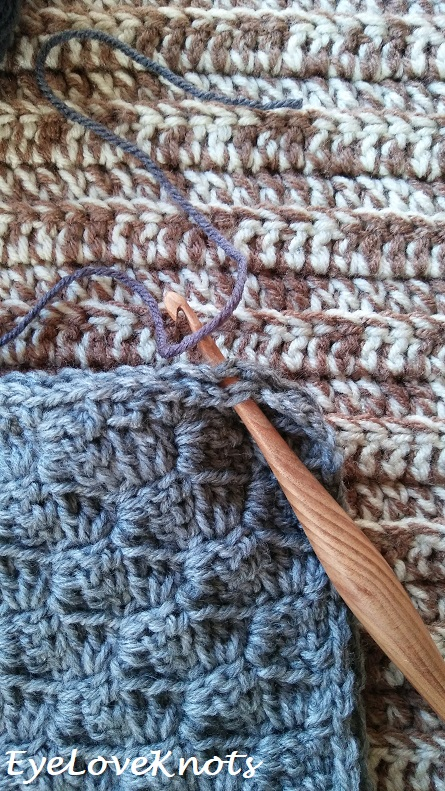Close up of where to join the yarn in crochet pillow assembly
