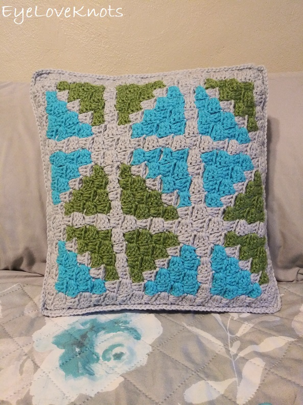 Finished C2C Window Pane Throw Pillow on a bed