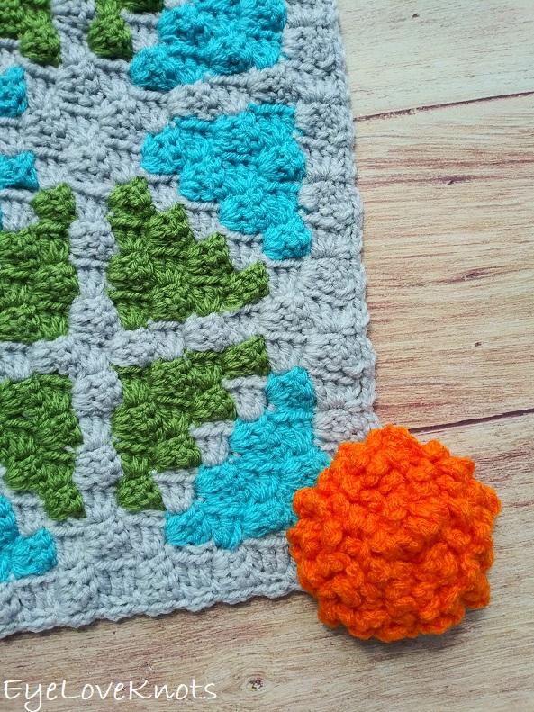 Finished image of C2C Window Pane Square with orange flower