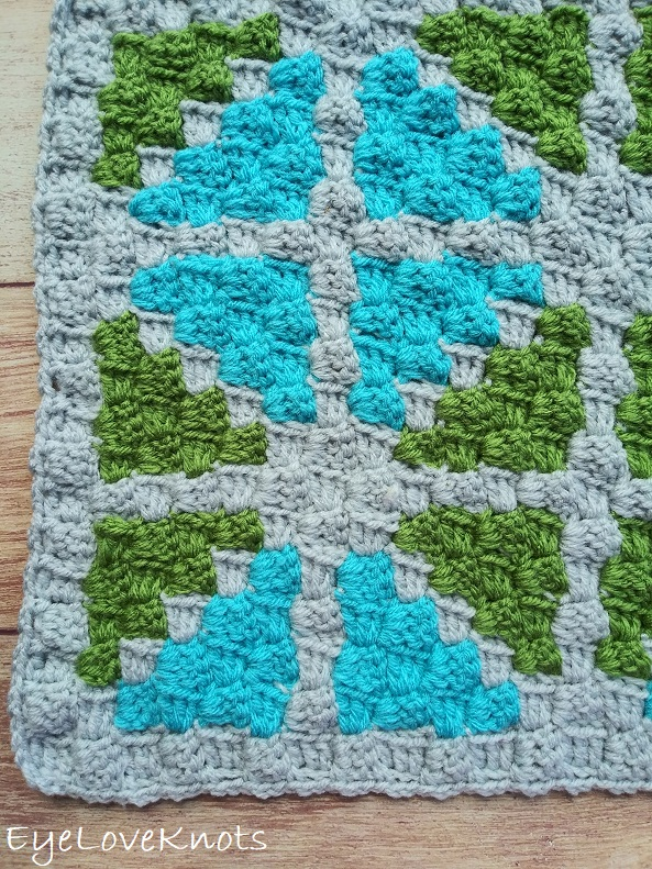 Finished image of C2C Window Pane Square - a geometric print of blue and green triangles.
