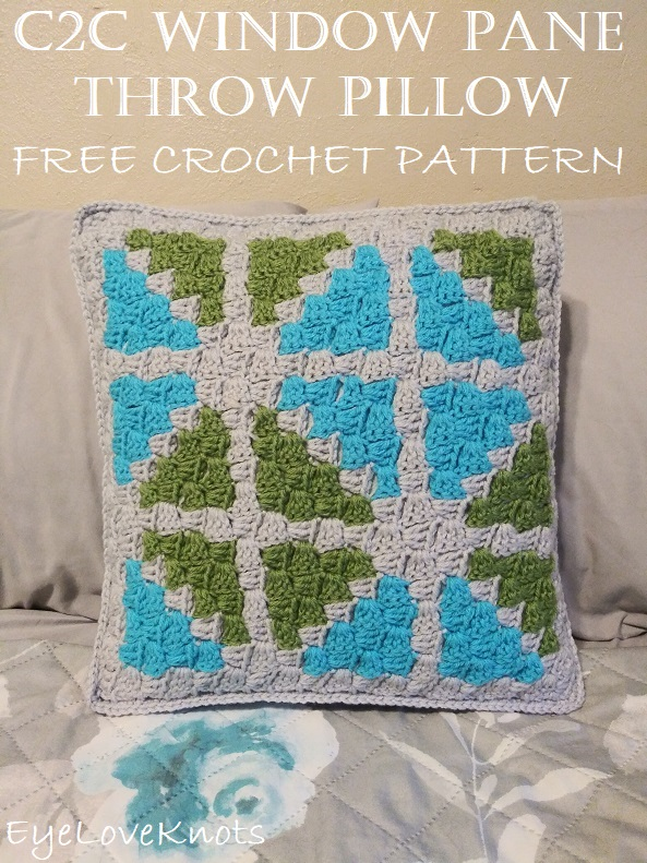 Title image showing finished C2C Window Pane Throw Pillow on a bed.