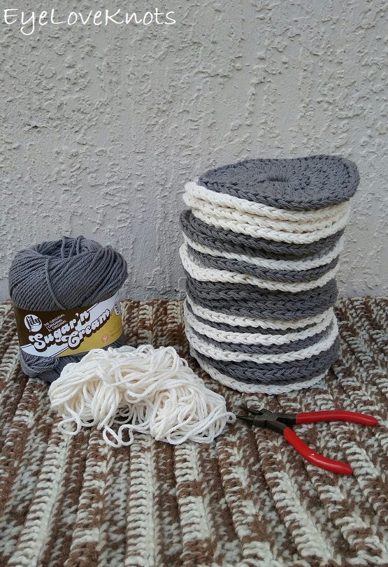 Pile of gray and cream circle motifs