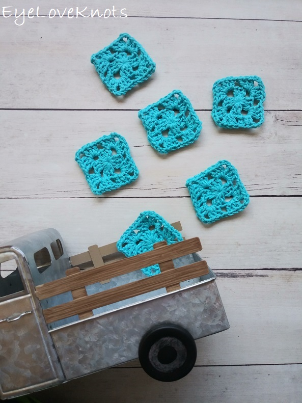 6 blue granny squares laid out