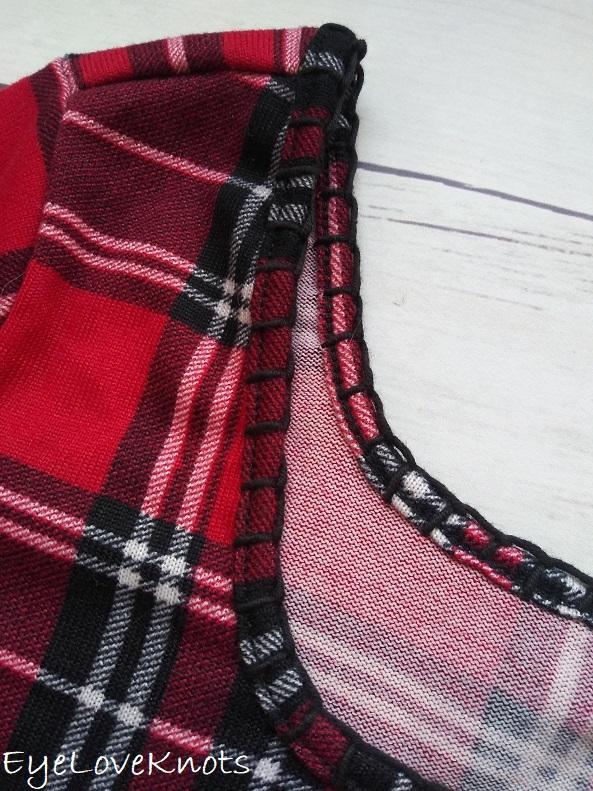 Close up of blanket stitch edging around neckline of plaid shirt