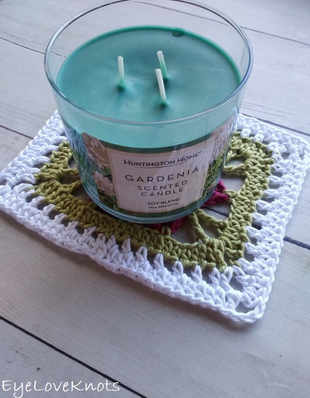 crocheted floral doily with Gardenia scented green candle, EyeLoveKnots, Lily's Floral Rectangle Doily