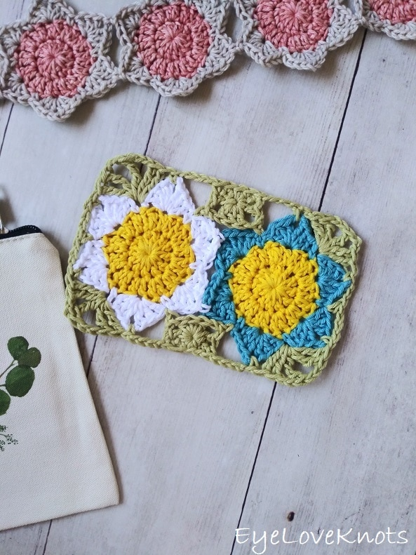 crocheted floral mug rug with white and blue flowers EyeLoveKnots