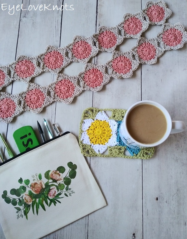 floral mug rug with cup of coffee on top, beige and coral crocheted floral, canvas crochet hook pouch EyeLoveKnots