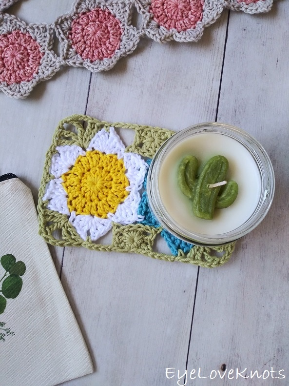 floral mug rug with cactus candle on top EyeLoveKnots